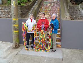 Photo: Photograph by Steve Bowles/San Francisco Parks Alliance: Organizing committee members (from left) Barbara Meli, Liz McLoughlin, and Judy Godess preparing for ribbon-cutting on the day of the opening celebration (Saturday, December 7, 2013) for the Hidden Garden Steps (16th Avenue, between Kirkham and Lawton streets in San Francisco's Inner Sunset District)  For more information about the Steps, please visit our website (http://hiddengardensteps.org), view links about the project from our Scoopit! site (http://www.scoop.it/t/hidden-garden-steps), or follow our social media presence on Twitter (https://twitter.com/GardenSteps), Facebook (https://www.facebook.com/pages/Hidden-Garden-Steps/288064457924739) and many others.
