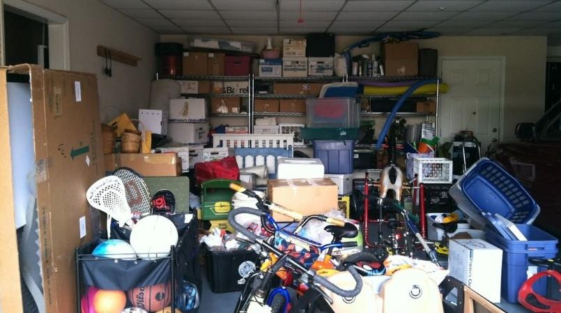 messy garage ready for DIY garage organization