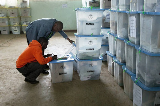Officers from the Independent Electoral and Boundaries Commission inspect ballot boxes at the Mathare counting centre on August 9 2017. Picture: EUROPEAN PRESS PHOTO AGENCY