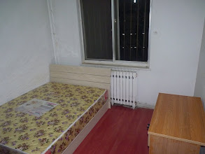 Photo: Beijing - 1st room to check in 1st floor (ground level) of 18fl building, not nice surroundings, 3 out of 4 bedrooms available, no living room, no kitchen, no internet (must subscribe on my own), crappy bathroom, quite cold, desk, wardrobe, bed, 1400RMB/month (+utilities), another separated room (created artificially, not with brick/concrete walls) for 1200RMB