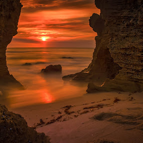 Between the Rocks by Keith Walmsley - Landscapes Sunsets & Sunrises ( water, clouds, nature, sunset, landscape, rocks, natural )