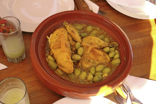 Lifting the lid on a delicious, fragrant tagine. Picture: MADELEINE MORROW