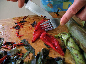 Photo: peeling roasted fresno peppers