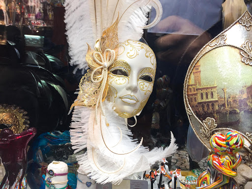 Venice-womans-mask-3.jpg - A woman's mask in the traditional Venetian style in a shop window along the Procuratie Vecchie on Piazza San Marco, Venice.