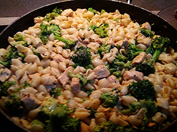 In large pot cook pasta as package directs and drain.   Steam broccoli...