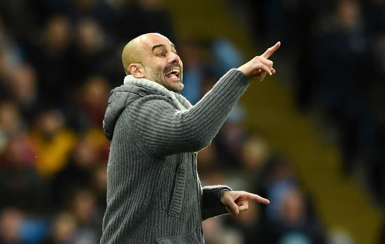 Josep Guardiola, Manager of Manchester City gives his team instructions during the UEFA Champions League Round of 16 Second Leg match between Manchester City v FC Schalke 04 at Etihad Stadium on March 12, 2019 in Manchester, England.