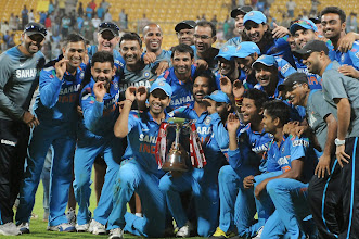 Photo: Indian players celebrate with the trophy after winning the 7th ODI between India and Australia played at Chinnaswamy Stadium in Bangalore on Nov.2, 2013. (Photo: IANS)