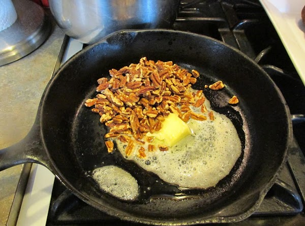 Melt 1/4 stick of butter in cast iron skillet and add chopped nuts.Stir Over...