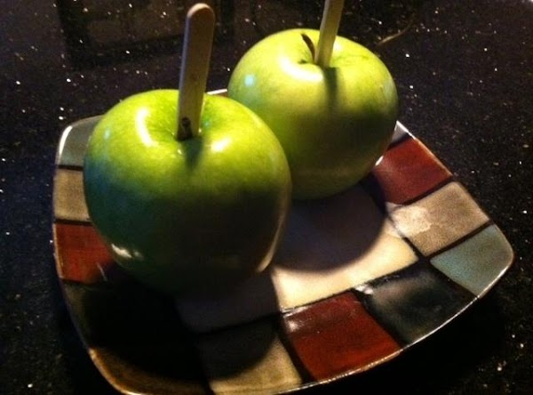 PLACE POPSICLE STICKS INTO APPLES N LINE A PLATE WITH WAX PAPER...IN A MICROWAVE...