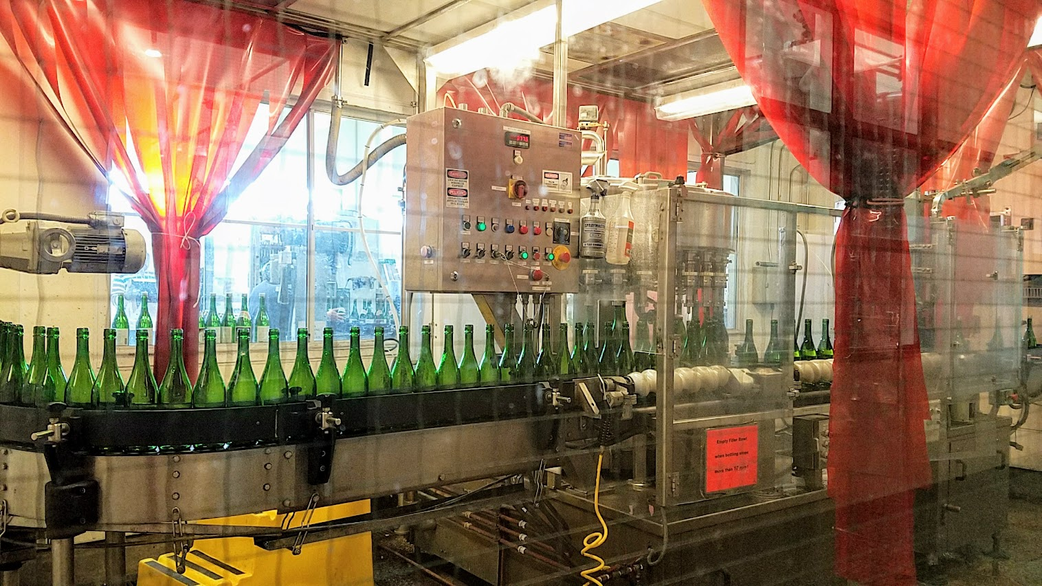 Bottling process for the sake that can be seen during the free self guided brewery tour at Gekkkeikan Sake in Folsom, California