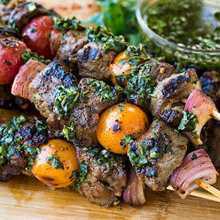 Grilled Steak Kebabs with Chimichurri Sauce.