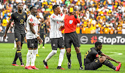 Happy Jele of Orlando Pirates challenges  referee Luxolo Badi  during the Soweto Derby in February. Some refs say they haven't been paid since March when football was halted.