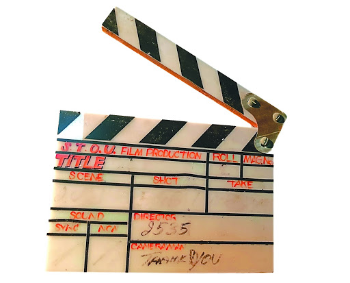 A clapperboard used by Sukhothai Thammathirat University