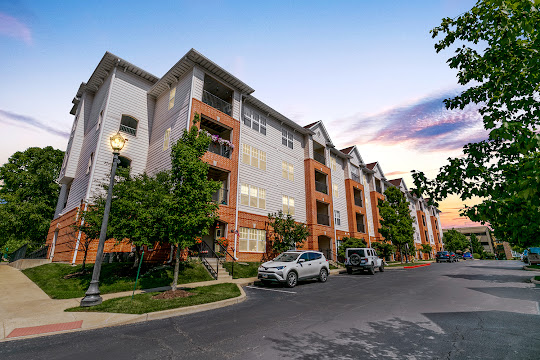 Kirkwood Station Plaza's exterior of the apartment buildings at dusk