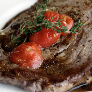 Rib Eye Steaks with Olive Oil Poached Tomatoes and Honey Balsamic Drizzle