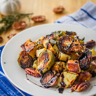 Roasted Sweet Potatoes and Brussels Sprouts with Pecans and Balsamic Reduction