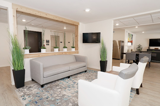 Community clubhouse seating area with modern furniture and accents