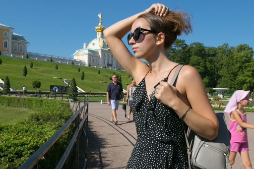 Peterhof-Palace-visitor.jpg - A visitor to Peterhof Palace near St. Petersburg, Russia. Expect crowds. Lots of them.