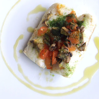 Hake Fillets with Tomatoes and Mushrooms.