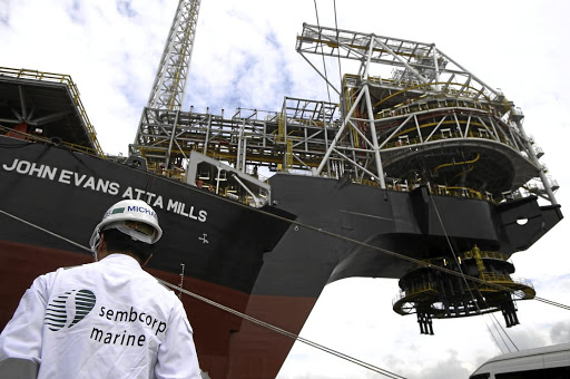 Delivered: An employee stands near the turret of Tullow Oil's vessel in Singapore. Picture: REUTERS
