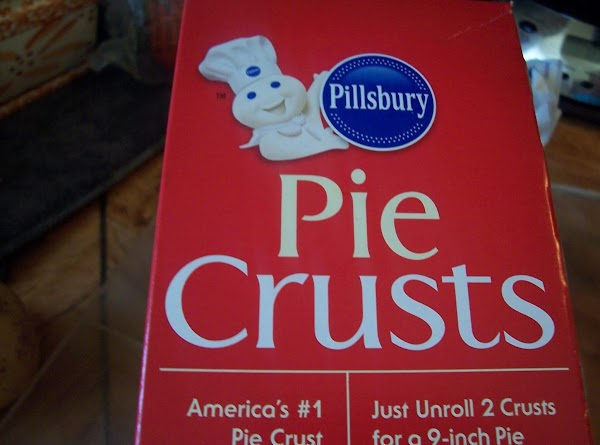 Preheat oven according to pie crust instructions.  Unroll pie crust and gently press into a...