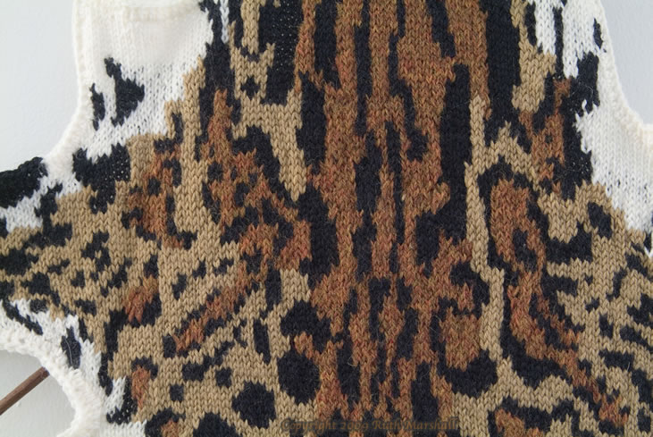 """Photo: #2 Ocelot  2009  53"""" x 31""""  (134cm x 78cm) Hand knitted textile. Interpretation of ocelot based on study of actual pelt at American Museum of Natural History. Male - collected from Brazil, 1930. Yarn, string, sticks.  (C) Ruth Marshall, 2009."""