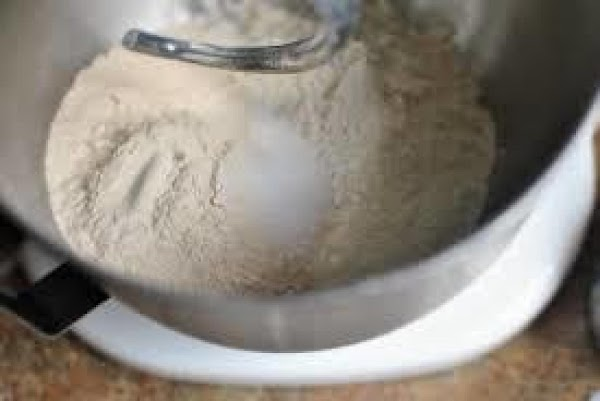 In bowl of a stand mixer, combine oats, flour, yeast and salt. In a...