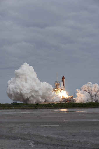 Amid the tranquility space shuttle Endeavour rumbles off Launch Pad 39A at NASA's Kennedy Space Center.
