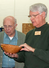 Photo: Gary Nickerson talks about his maple burl bowl.