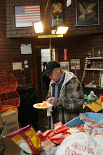 Photo: A Staten Island resident eats a warm meal at a makeshift community outreach center in the New York borough Nov. 7. The center was hastily set up by a group of friends following Hurricane Sandy.(CNS photo/Bob Roller) (Nov. 8, 2012) See SANDY-STATENISLAND Nov. 8, 2012.