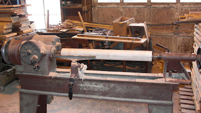 Photo: Square stock is milled into round core on a lathe...