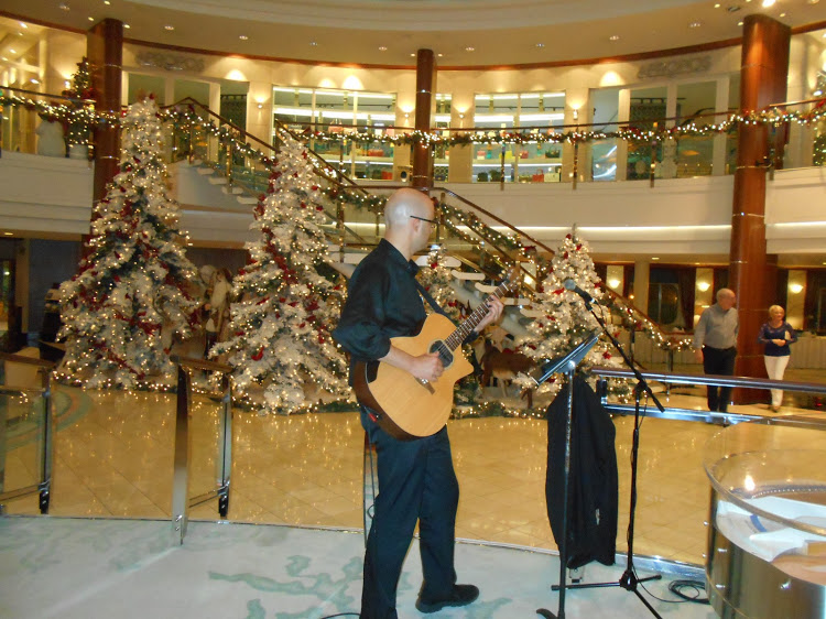 A guitarist performs in the Crystal Cove piano bar, decked out in Christmas décor.