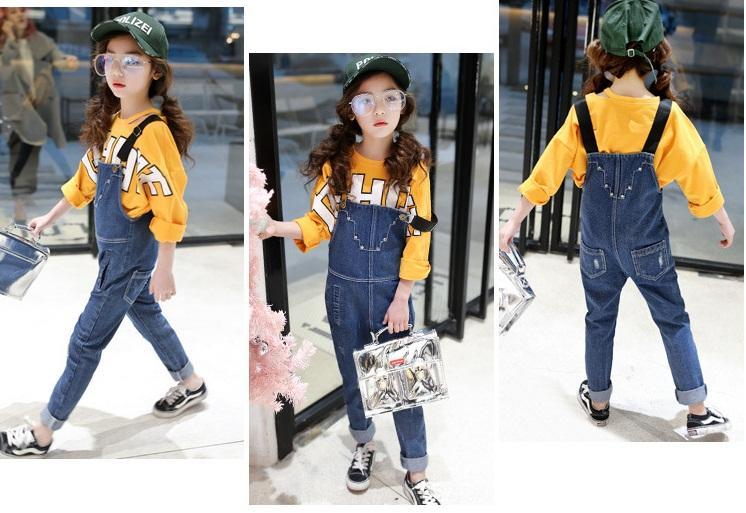 spodnie ogrodniczki jeansowe z dziurami dla dziewczynki10
