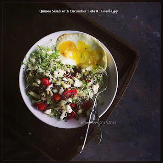Quinoa Salad with Cucumber, Feta and Fried Egg.
