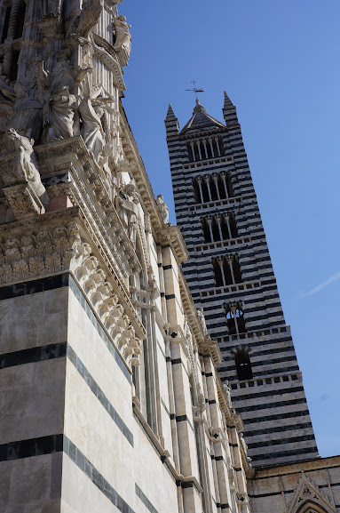 View of the adjacent tower of the Duomo of Siena