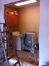 """Photo: The view from my garage looking into the laundry room. The new cabinets will stick out about 12 - 24"""" depending on the depth of the cabinets."""