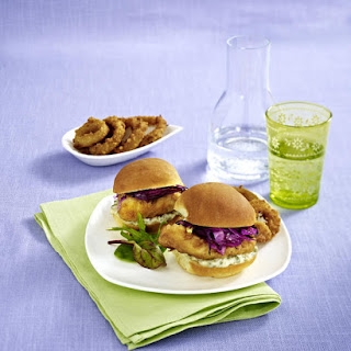 Fried Fish Sandwich with Onion Rings and Tartar Sauce.