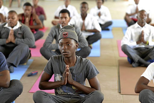 Sound of silence: Pupils at Alexandra High School in Johannesburg go through their yoga paces. Picture: SUZY BERNSTEIN