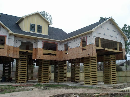 A house must be elevated to allow construction of a new foundation.