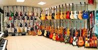 Магазин музыкальных инструментов «Muzline», проспект Владимира Маяковского на фото Киева