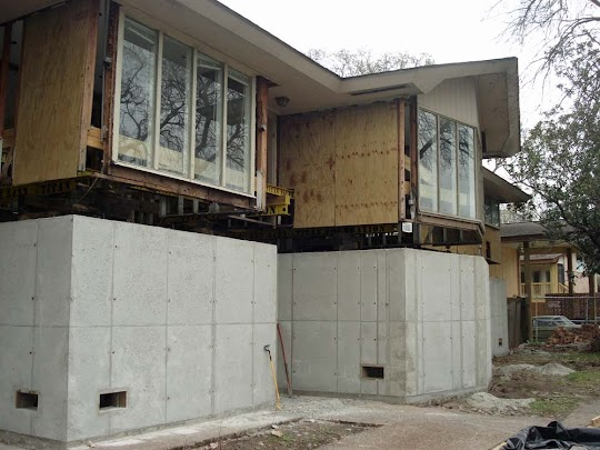 New Foundation Walls Have Been Constructed Under An Elevated House.