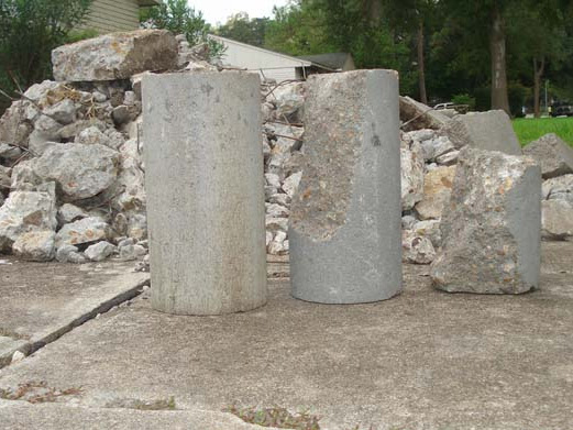 Broken concrete cylinders used in a low quality foundation repair method