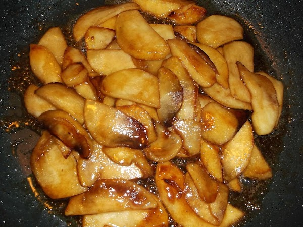 Stir and cook until brown sugar is dissolved and apples appear reduced in volume...