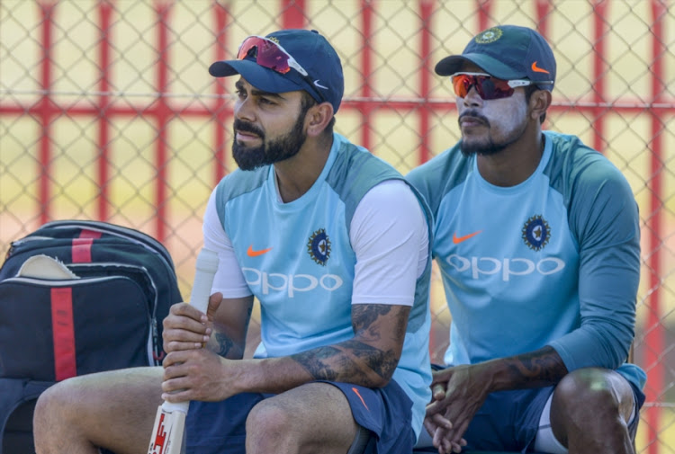 Captain Virat Kohli and Umesh Yadav of India during the Indian national men's cricket team training session and press conference at SuperSport Park on January 12, 2018 in Pretoria, South Africa.
