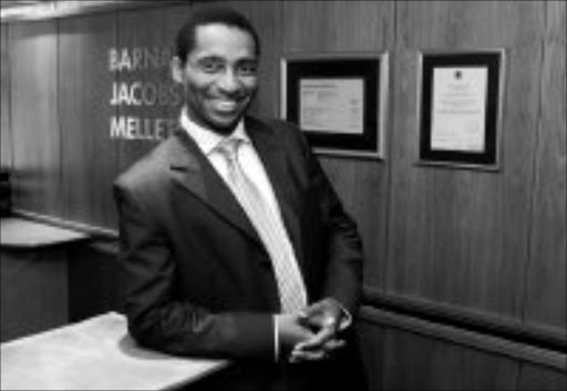 KNOWING NUMBERS: Barnard Jacobs Mellet Securities chief executive officer Andile Mazwai says stock broking has provided him with an opportunity to perfect his entrepreneurial skills. Pic. Russell Roberts. 15/05/06. © Financial Mail.