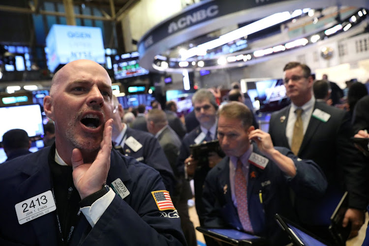 Traders work on the floor at the New York Stock Exchange in New York City, the US. Picture: REUTERS/BRENDAN MCDERMID