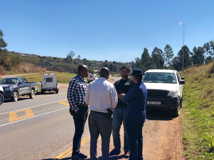 Magma Investigations head Shaheen Sulieman with police at the scene of arrest of one of the men linked to the murder of farmer Peter Scott at the weekend.