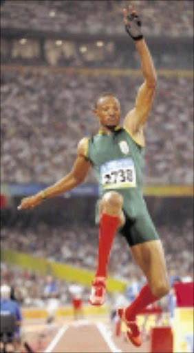 South Africa's silver medal winner Khotso Mokoena makes an attempt in the final of the men's long jump during the athletics competitions in the National Stadium  at the Beijing 2008 Olympics in Beijing, Monday, Aug. 18, 2008.  (AP Photo/Thomas Kienzle)\n\nLONE RANGER: Team SA's silver medallist Khotso Mokoena. page 32, sow