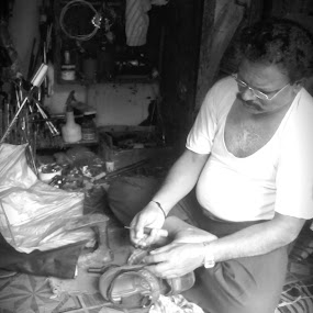 Cobbler by Naveed Dadan - People Street & Candids ( black and white, art, street, india, travel, people, portrait, man, photography, city )