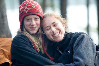 Photo: Two young sisters smiling while camping on Jackson Lake. Grand Teton NP, WY